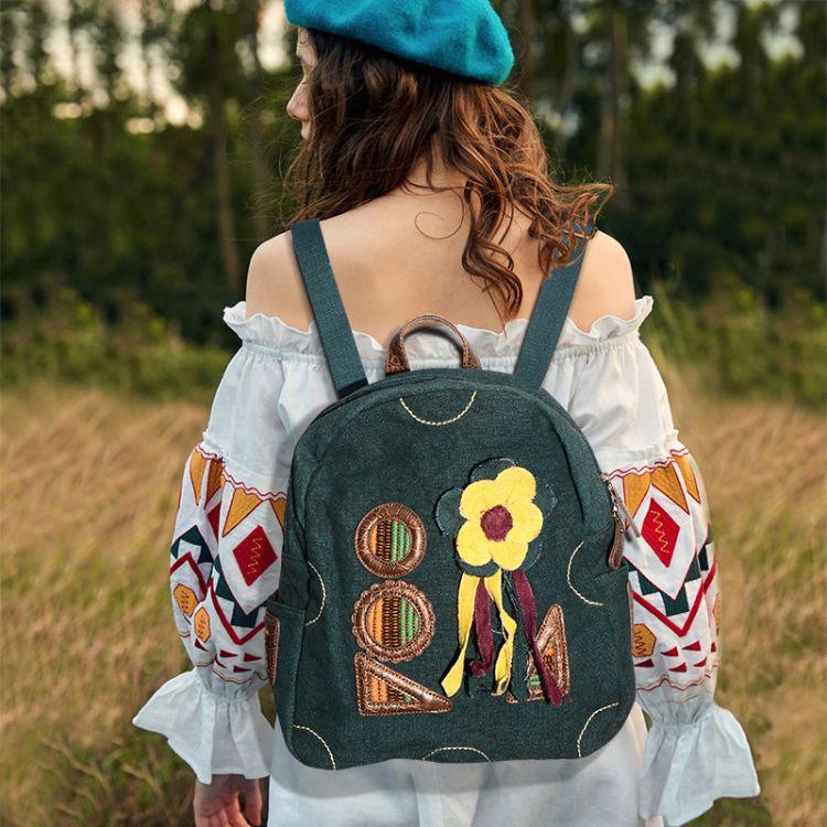 翘朵2018冬季新款民族风文艺女生花朵棉麻双肩包大号旅行背包书包