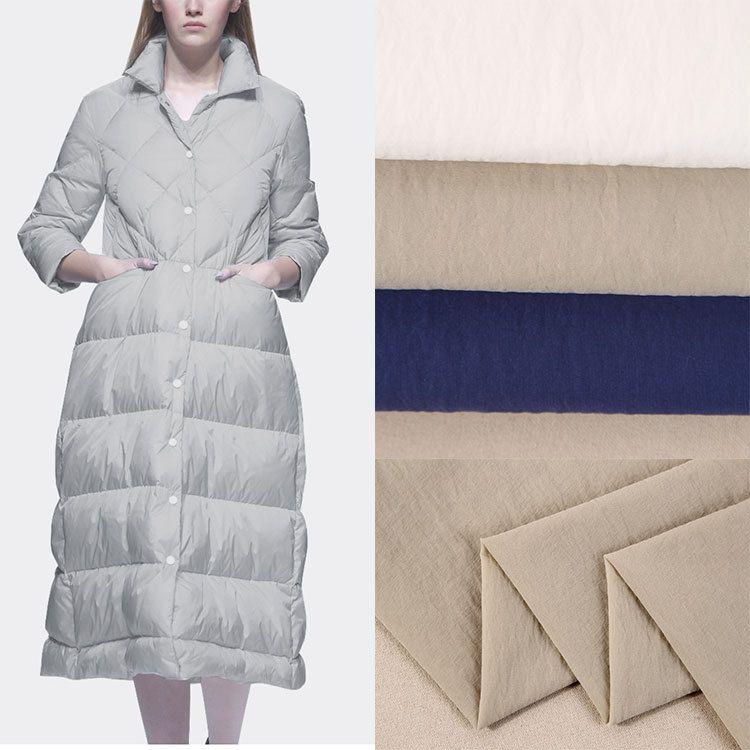 厂家现货纬弹绉尼龙布料 平纹染色羽绒服面料 新款休闲棉衣用布