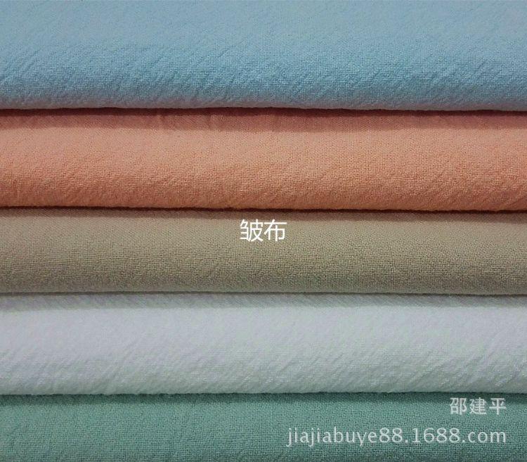 厂家推荐现货纯棉洗水绉布现货全棉强捻砂洗皱布男女休闲服装面料