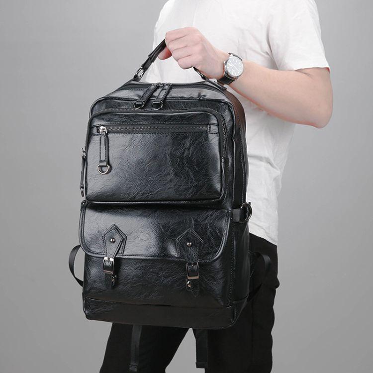 批发新款男士时尚背包 韩版仿真皮休闲双肩背包电脑包书包一件代