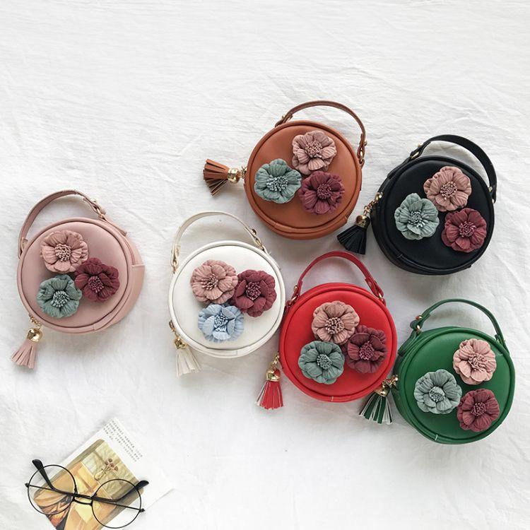 厂家直销儿童包三朵花女童斜挎包PU零钱包花朵包手提圆包幼儿小包